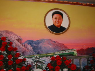 The Ministry of Railways' painting of a train that Kim Jong Il once rode in; he was said to have died on a train while traveling tirelessly to oversee the well-being of his people (Kimjongilia Exhibition, 2002)