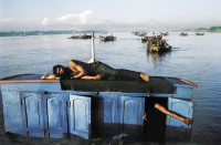 Boatmen on the Hooghly River, Calcutta, 2000; photograph by Raghu Rai from Raghu Rai's India: Reflections in Colour, just published by Haus Publishing