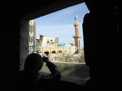 A Palestinian looking at the ruins of the al-Fadilah mosque, destroyed during an Israeli air strike on Rafah, in southern Gaza, January 11, 2009