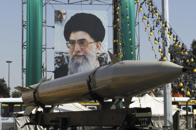 A poster of Ayatollah Khamenei hanging behind a missile on display at a military exhibition marking the twenty-eighth anniversary of the beginning of the Iran–Iraq war, Tehran, September 23, 2008