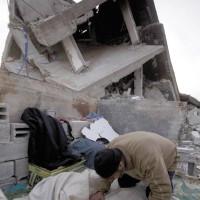 A Palestinian praying by the ruins of his house, Jabalya, Gaza, January 26, 2009