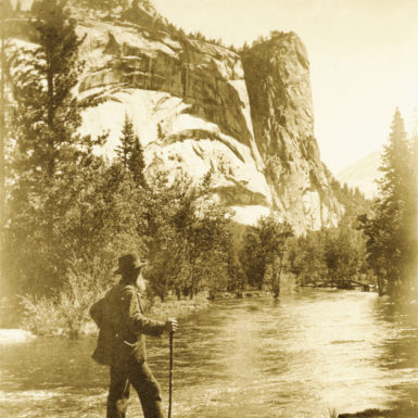 John Muir at the Merced River, with the Royal Arches and the Washington Column in the background, Yosemite National Park, California, circa 1909