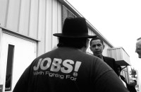 Barack Obama meeting with representatives of the United Auto Workers at a Mitsubishi factory in Bloomington, Illinois, during his campaign for the US Senate, May 2004
