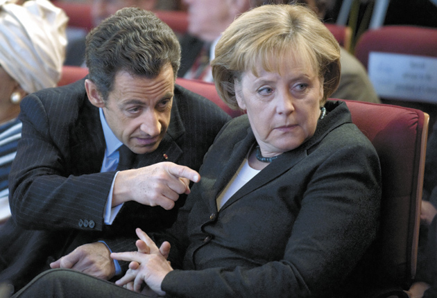 French President Nicolas Sarkozy and German Chancellor Angela Merkel at the 'New World, New Capitalism' symposium, Paris, January 8, 2009. Amartya Sen also attended the symposium.