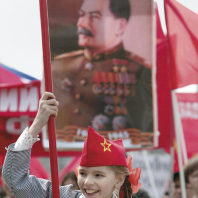 A pro-Communist demonstration in Moscow, with a portrait of Stalin in the background, May 1, 2005