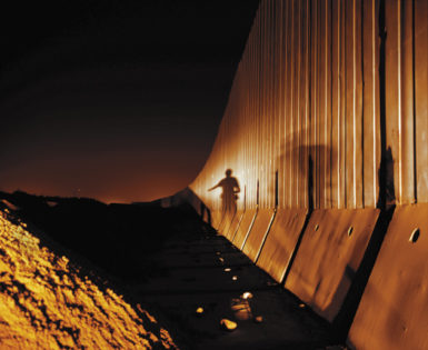 The Israeli side of the separation wall, shielding the Trans-Israel Highway from the West Bank town of Qalqilya, July 2002