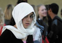 A student in northern France, arriving at school in a Muslim headscarf, September 2, 2004. She removed the headscarf, in accordance with the French ban on wearing highly visible religious symbols in public elementary and secondary schools.