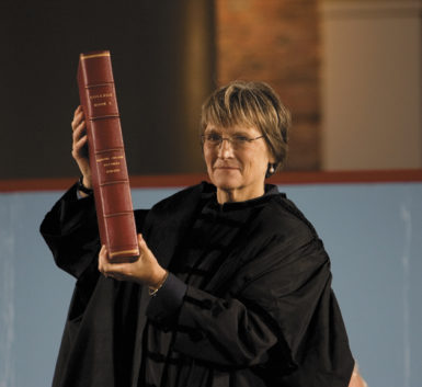 Drew Gilpin Faust during her swearing-in as president of Harvard University, Cambridge, Massachusetts, October 2007. She is holding College Book I, a compilation of official Harvard records from 1639 to 1795.