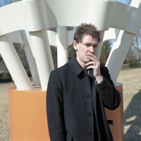 Clancy Martin in front of Claes Oldenburg's sculpture Shuttlecocks, at the Nelson-Atkins Museum of Art, Kansas City, Missouri, February 2009; photograph by Daniel Shea