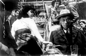 Miki Odagiri as the secretary and Takashi Shimura as the bureaucrat in Akira Kurosawa's Ikiru (To Live; 1952)