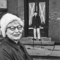 Jane Jacobs with her son Ned in front of a Greenwich Village building, designated for demolition by the City Planning Commission, 1961; photograph by Ruth Orkin from Anthony Flint's Wrestling With Moses