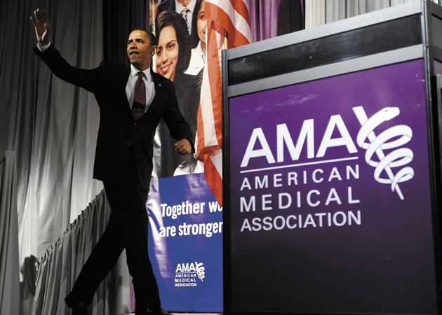 Obama arrives to deliver a speech on health care to the American Medical Association in Chicago, Illinois