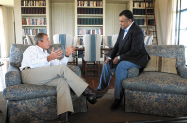 George W. Bush and Saudi Arabian Ambassador Prince Bandar bin Sultan at the President's ranch, Crawford, Texas, August 27, 2002