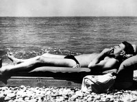 Guy Burgess, a member of the Cambridge Five spy ring who passed information to the Soviets from the 1930s until his defection to the USSR in 1951, sunbathing on the shore of the Black Sea, 1956