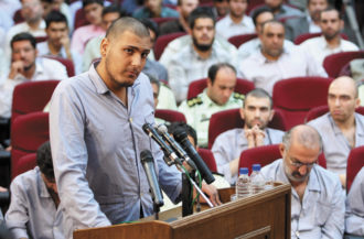 An unidentified defendant at a trial of alleged offenders, Tehran, August 16, 2009