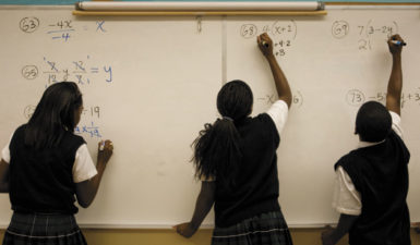 Eighth-grade students working out algebra problems at Robert Treat Academy, a charter school in Newark, New Jersey, September 16, 2008