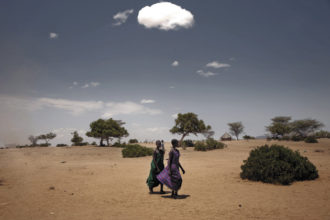Young women walking to a food relief center in the drought-stricken village of Nadapal, Rift Valley province, Kenya, October 2, 2009; photograph by Stefano De Luigi