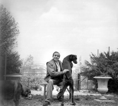 Louis-Ferdinand Céline with his dogs, Meudon, France, circa 1955
