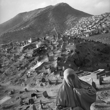 An Afghan woman at a Shiite cemetery in Kabul, 2001; photograph by Abbas from In Whose Name? The Islamic World After 9/11, a collection of his recent images from Afghanistan, Iraq, Iran, and other countries, just published by Thames and Hudson