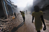 Survivors of the Haiti earthquake on Grand Rue, the main street in Port-au-Prince, January 18, 2010