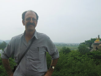 David Shulman near a temple to Sarasvati, the Hindu goddess of arts and learning, on the banks of the Godavari River in Basara, Andhra Pradesh, India, 2006