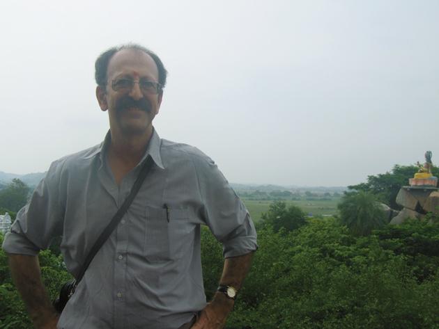David Shulman near a temple to Sarasvati, the Hindu goddess of arts and learning, on the banks of the Godavari River in Basara, Andhra Pradesh, India, 2006