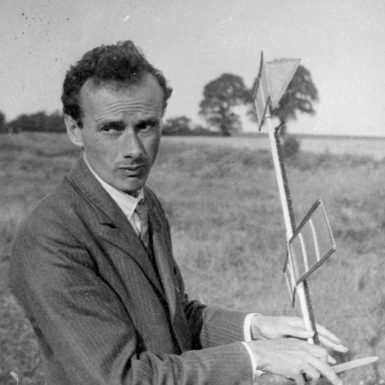 Paul Dirac, one of the discoverers of quantum mechanics, with part of a model airplane he was building with the physicist Patrick Blackett, near Thorpe-le-Soken, Essex, England, 1933