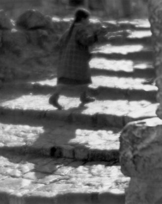 Child backlit on steps, 1920s, by the Hungarian photographer Martin Munkacsi