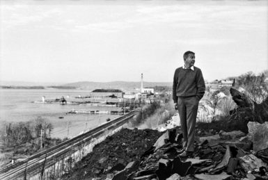 John Cheever standing above Sing Sing prison in the town of Ossining, New York, where he lived from 1961 until his death in 1982; from ,Harry Benson: Photographs, just published by powerHouse Books