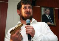 Chechen President Ramzan A. Kadyrov, with a portrait of Russian Prime Minister Vladimir Putin, February, 2009
