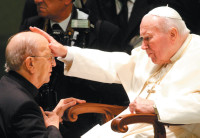 Pope John Paul II blessing Father Marcial Maciel at the Vatican, November 30, 2004
