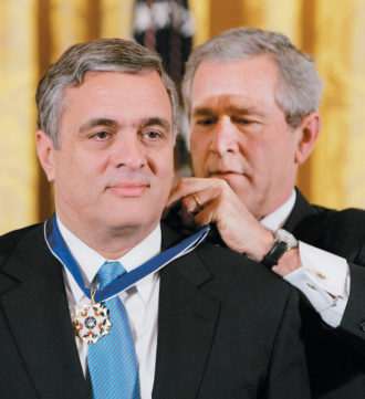 George W. Bush awarding the Presidential Medal of Freedom to former CIA director George Tenet, Washington, D.C., December 2004