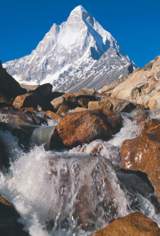 Shivling peak above the Gangotri glacier, whose meltwater is seen in the foreground, Uttarakhand, India, January 2008