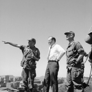 From left, Lieutenant Colonel John C. Hughes briefing McGeorge Bundy and General William C. Westmoreland on the recent Vietcong attack on Pleiku, South Vietnam, February 10, 1965