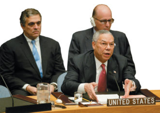 Secretary of State Colin Powell at the UN Security Council presenting evidence of Iraqi WMDs, with CIA Director George Tenet and US Ambassador to the UN John Negroponte, February 5, 2003