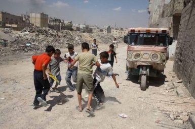 Children playing in a neighborhood populated mostly by Iraqi refugees, Damascus, Syria, August 2007