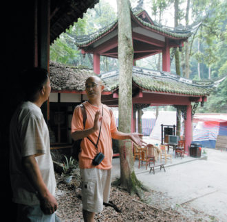 The Chinese writer Liao Yiwu, right, with a caretaker at the ancient Buddhist Gu Temple, which was damaged in the Sichuan earthquake, June 6, 2008