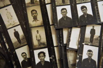 Contact sheets showing pictures of prisoners of S-21, the Khmer Rouge prison in Phnom Penh where at least 12,273 people died