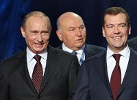 Former Mayor of Moscow Yuri Luzhkov (center) with Prime Minister Vladimir Putin and President Dmitry Medvedev
