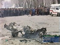 An image taken from Russian Independent Television showing Tajiks looking on after a car loaded with explosives blew up in the Tajik capital Dushanbe, January 31, 2005