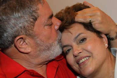 Brazil's President Luiz Inacio Lula da Silva, left, kisses newly elected leader Dilma Rousseff at the Alvorada palace, Brasília, November 1, 2010