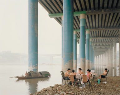 Sunday picnic, Chongqing, 2006; photograph by Nadav Kander from his book Yangtze—The Long River, which collects his images of life along the Yangtze from its mouth near Shanghai to its source on the Tibetan Plateau. It has just been published by Hatje Cantz.