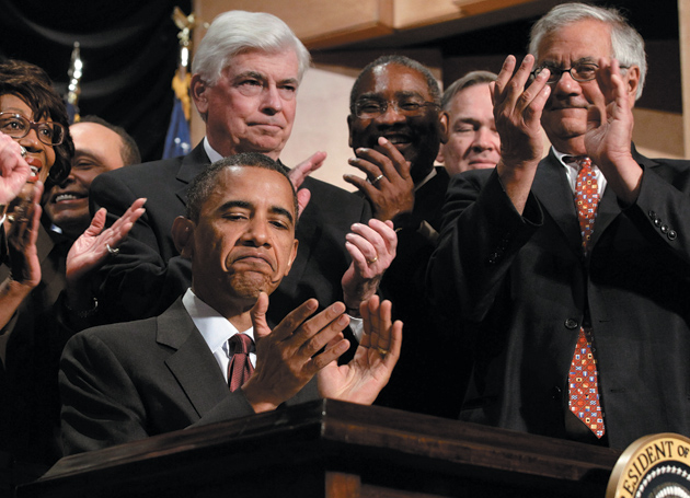 President Barack Obama, Senator Christopher Dodd (center left), and Representative Barney Frank (right) at the signing of the Dodd-Frank Wall Street Reform and Consumer Protection Act, Washington, D.C., July 21, 2010