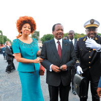 Cameroon's President Paul Biya, center, with his wife Chantal Biya at a Bastille Day parade on the Champs Elysées, Paris, July 14, 2010