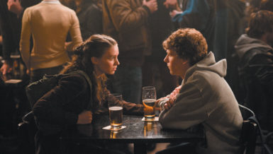 Jesse Eisenberg as Mark Zuckerberg, the founder of Facebook, and Rooney Mara as his girlfriend Erica in The Social Network