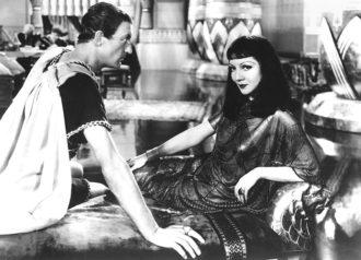 Warren William, as Julius Caesar, and Claudette Colbert in Cleopatra, 1934