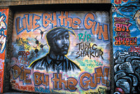 A mural of the murdered rapper Tupac Shakur by the graffiti artist Andre Charles, Houston Street, New York City, 1997