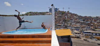 Children playing in a pool after a police raid on the house of the chief drug dealer of the Morro do Alemao favela, Rio de Janeiro, November 28, 2010