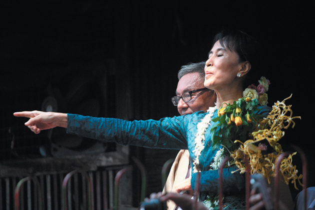 Aung San Suu Kyi addressing supporters at the National League for Democracy headquarters in Rangoon after her release from house arrest, November 14, 2010