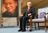 Nobel Committee Chairman Thorbjørn Jagland looking at the empty chair reserved for the Nobel Peace Prize winner Liu Xiaobo, December 10, 2010. According to news reports, since the award ceremony, the Chinese words for 'empty chair' have been banned on the Chinese Internet and some bloggers who have used the phrase or posted images 